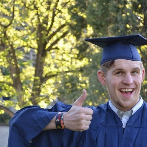 Student in a graduating hat and gown